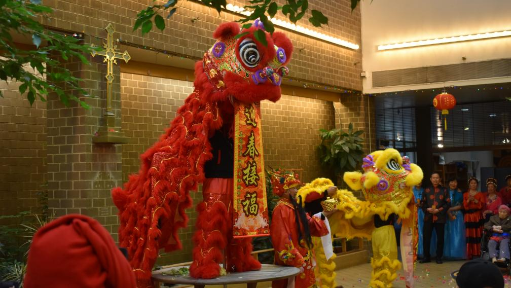 Red and yellow giant puppets of lions for Lunar New Year