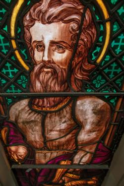 St. Luke represented in the stained glass in Trinity Church.