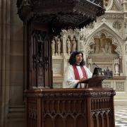 The Rev. Winnie Varghese in pulpit on Good Friday