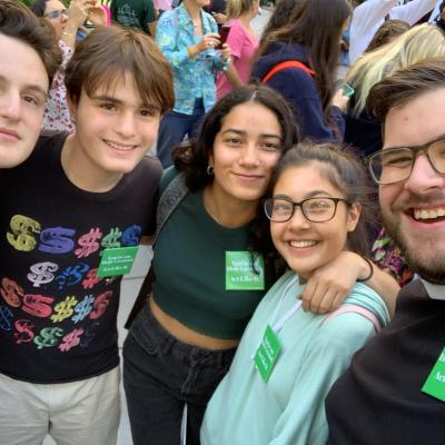 A group of youth and Father Matt at Climate March in 2019.