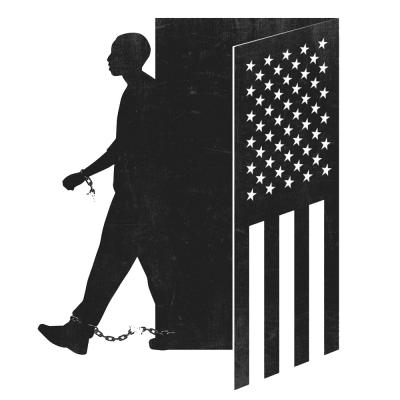 A man walks out of a door shaped like an American Flag. The chains on his wrist and ankle break as he hits his stride.