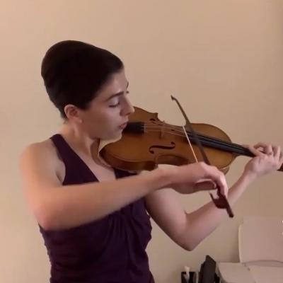 Violinist Alana Youssefian performs on a cream background.