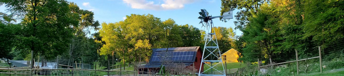 Corn field, Barn with solar panels and a windmill