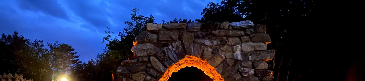 The top of the Retreat Center's stone arch in the early evening
